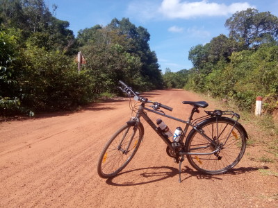 Taking it slow, riding with a broken spoke on a dirt track on Phu Quoc island.